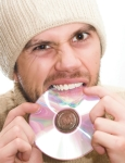 man eating cd